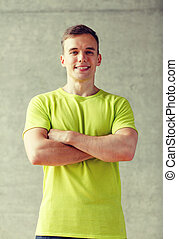 smiling man in gym - sport, fitness, lifestyle and people...