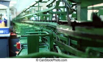 Conveyor in workshop production of footwear - View of...