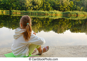 child relaxing on the beach - little gilr relaxing on a...