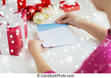close up of woman with letter and presents - holidays,...
