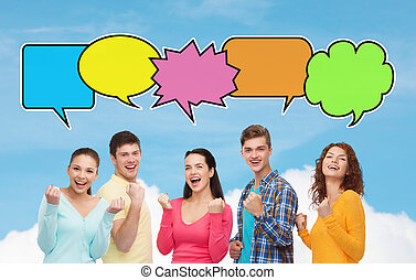 group of smiling teenagers showing triumph gesture -...
