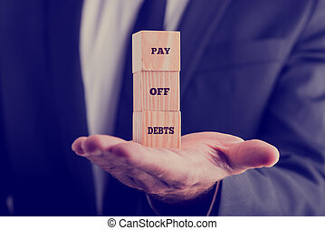 Pay off debts - Retro image with a businessman holding a...