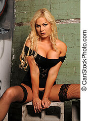 Blonde - Beautiful blonde in black lingerie sitting on...