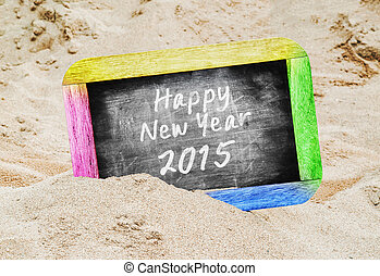 Happy new year 2015 written over blackboard background