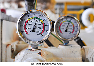 Pressure gauge for measuring pressure in the system, Oil and...