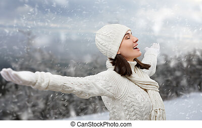 wintertime - beauty girl on the snow background