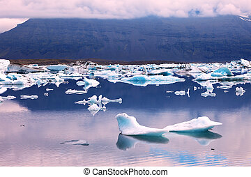 Pink sunset in July. Translucent icebergs in the Ice lagoon...