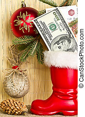 The money in the boot of Santa Claus and Christmas balls