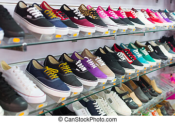 Shelves with casual shoes at store
