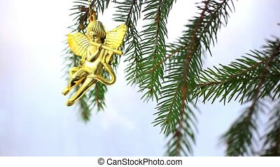 Christmas decoration with gold little angels on branch of...