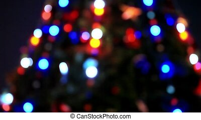 Bokeh of christmas tree decoration. Shift motion with change...