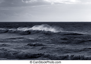 Moody seascape with windy wave. Toned blue. North of...