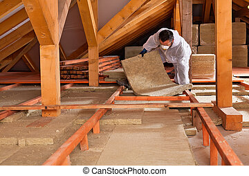 Man laying thermal insulation layer - Man installing thermal...