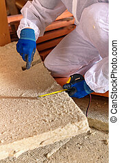 Man laying thermal insulation layer - closeup - Man...