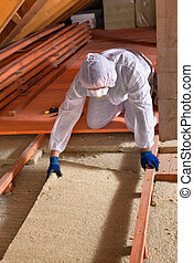 Man laying thermal insulation layer - wearing protective...