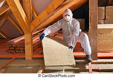 Man with rockwool panel installing insulation layer - Man...