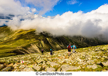 landscape with people exploring the mountains