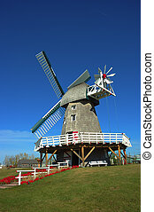 Portrait of a Prairie Windmill - Prairie windmill against a...