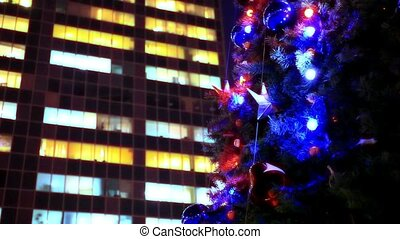 evening winter christmas tree and business center in the...
