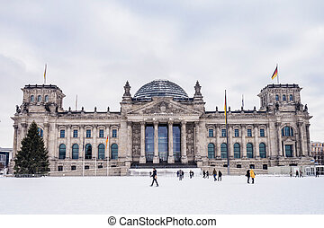 german parliament in winter - german parliament on a snowy...