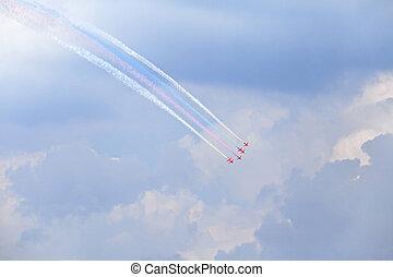 Air show - Planes on an air show against cloudy sky