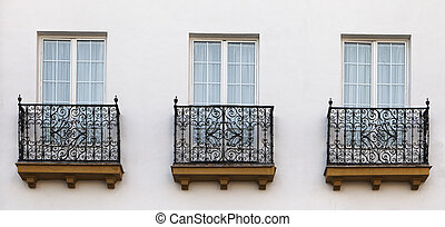 Balconies of a house in Seville - Decorative balconies of a...