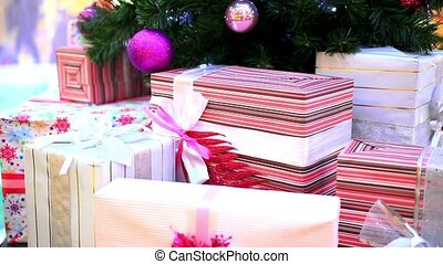 Christmas gifts under tree. Shift motion with change focus on blurred. HD. 1920x1080