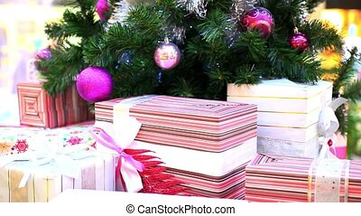 Christmas gifts under tree Shift motion with change focus on...