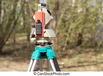 Electronic total station on tripod closeup