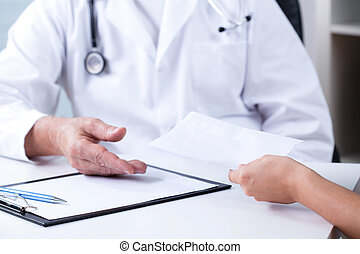 Private consultation - Senior male doctor and payment for...