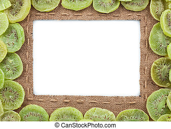 Frame made of burlap with dried kiwi, on a white background