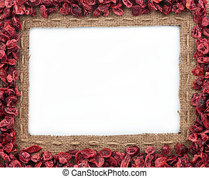 Frame made of burlap with dried cranberries, on a white...