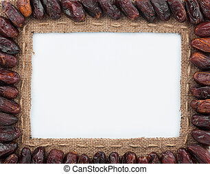 Frame made of burlap with dried dates, on a white background