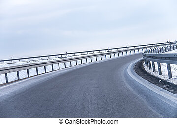 highway curve - a highway curve in winter near berlin