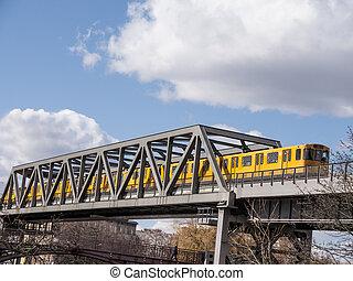 public transport - a train on a bridge in berlin in spring...