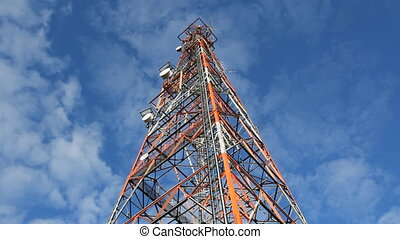Communication tower. Time lapse. - Low angle shot of red and...