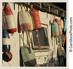 Vintage buoys - Old buoys on a wall on a shack in Maine,...