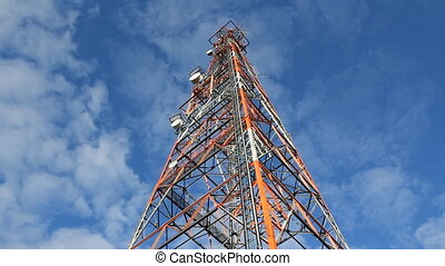 Communication tower Time lapse - Low angle shot of red and...