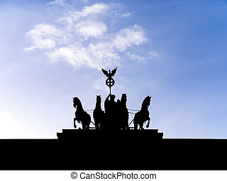 brandenburger tor in berlin with blue cloudy sky