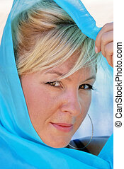 blonde haired woman in silk