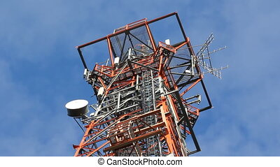 Communication tower. Time lapse. - Detail of top of red and...