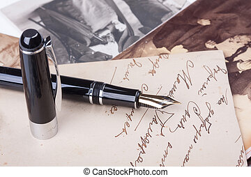 old fountain pen and old Photos close-up
