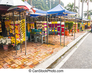 Traders selling flower wreath garlands - Batu Caves,...