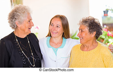 Elderly home care - Photo of elderly women and their carer