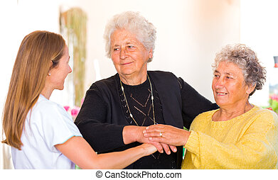 Elderly home care - Photo of elderly women with their carer