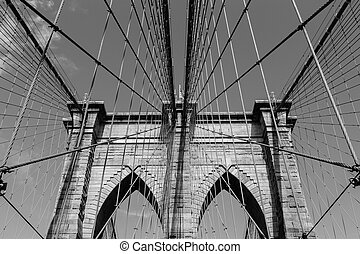 Arches of Brooklyn Bridge in NYC - A view of the arches of...