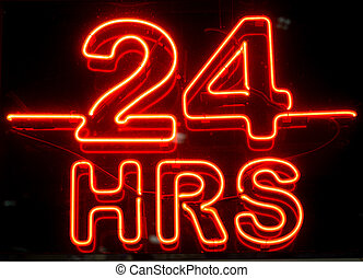 24 Hours Sign - A closeup to a bright neon 24 hours sign at...