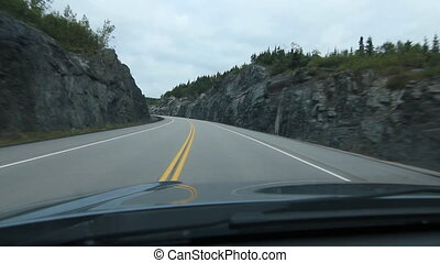 Driving through a rockcut. Ontario,