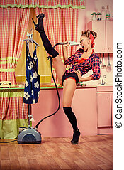 cabaret dance - Charming pin-up girl ironing her dress and...