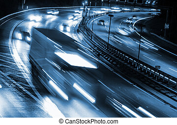 highway by night - cars on highway by night